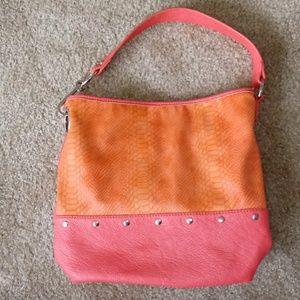 Carlos purse. Pink and orange shoulder strap.